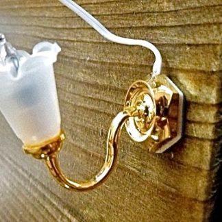 Wandlampe, Tulpenform. Messing/Kunststoff.