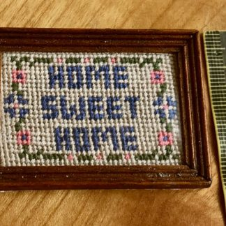 Bild (Home Sweet Home, gestickt, d'blau). Rahmen d'kl. Reduz.