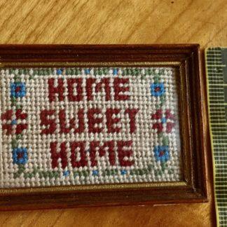 Bild (Home Sweet Home, gestickt, weinr.). Rahmen d'kl. Reduz.